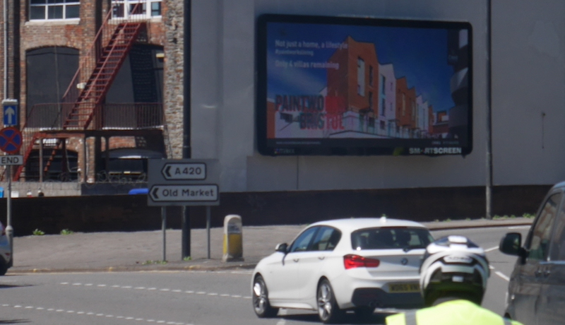 digital billboard on busy roundabout junction